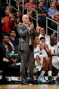 Chris Caputo feature story:  University of Miami basketball assistant coach Chris Caputo - a 2002 Westfield State graduate - signals in a play from the sidelines. Photo by HurricaneSports.com
