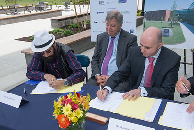 Brian Stevens (and his attorney, standing in for Brian's wife Kathy) sign an agreement with Westfield State University officials making permanent their $350,000 donation to the institution