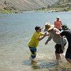 Salmon River Canyons, Idaho. Family playing in water together.