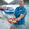 Salmon River Canyons, Idaho. Woman holding dinner plate.