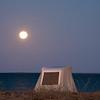 Mexico. San Ignacio Lagoon. Moon rising over tents.