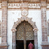 Mexico. San Ignacio. Mission San Ignacio Church. Man walking into church.