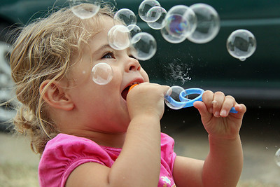 Lucia Blowing Bubbles