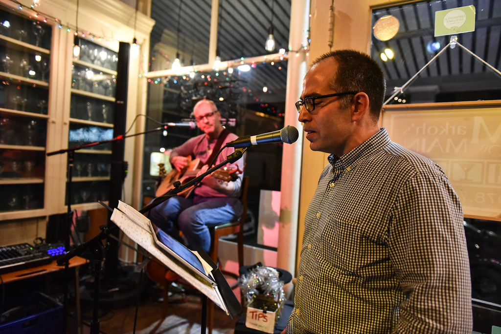 . (02/19/18 AYER MA)  John Llodra of Groton sings along to the tune of a guitar at Tuesday night\'s open mic night held at Markoh\'s On Main in Ayer.   SENTINEL & ENTERPRISE JEFF PORTER