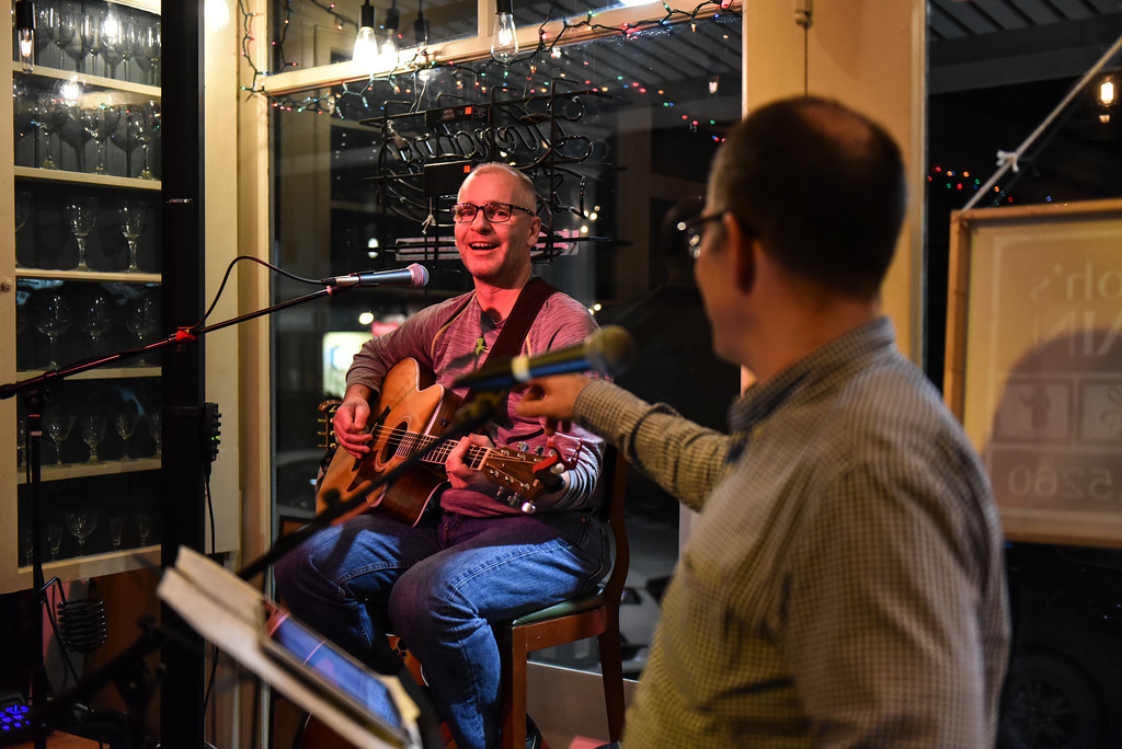 . (02/19/18 AYER MA) Steve Maclean of Clinton (left) plays the guitar as John Llodra of Groton sings along at Tuesday night\'s open mic night held at Markoh\'s On Main in Ayer. SENTINEL & ENTERPRISE JEFF PORTER