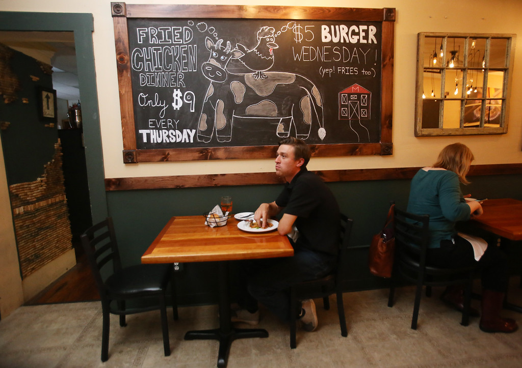 . Markoh\'s on Main restaurant in Ayer. Adam Morin of Ayer, who lives nearby, eats at Markoh\'s for the first time, attracted by $5 Burger night. (SUN/Julia Malakie)