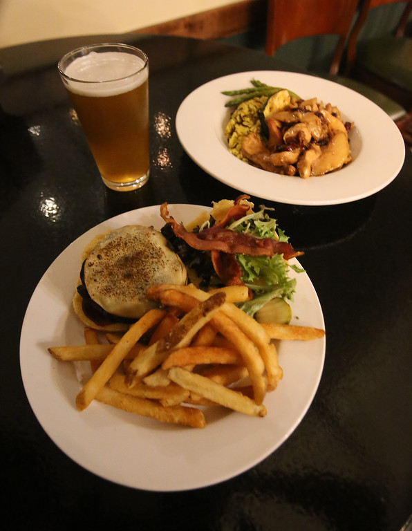 . Markoh\'s on Main restaurant in Ayer.  Smokehouse Burger, one of the burger options on $5 Burger Night, front, and Harvest Chicken (chicken with fresh sage, roasted butternut squash, apple cider reduction, and sometimes apples or pears, depending on what\'s good). (SUN/Julia Malakie)