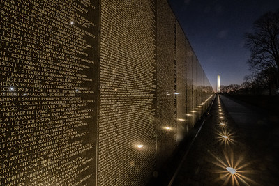 The Vietnam Memorial with the Washington Monument in the background
