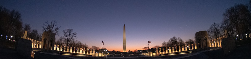 The World War II Memorial with the Washington Monument in the background just before sunrise.