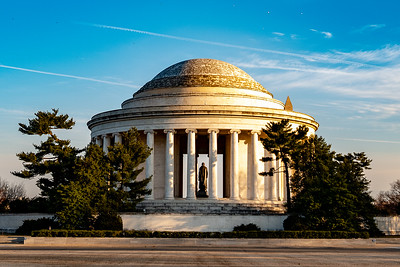 Sunrise in the Jefferson Memorial, with the tip of the Washington Monument showing
