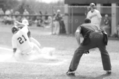 Senior Shane Haidet slides in safely in game 1 of a saturday double header with Waterloo. Marlington won both games, 16-2 and 13-1.