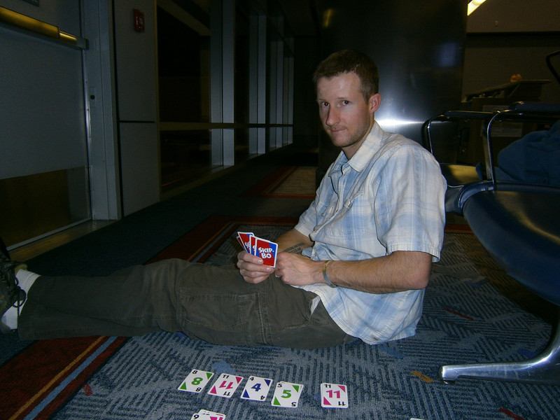 Playing Skip-Bo at the Denver airport. This was the only game I won during our trip.