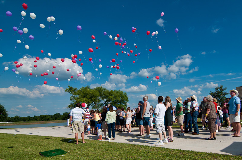 Hundreds of balloons soar skyward in memory of departed loved ones