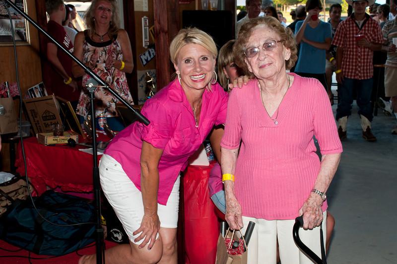 Hazel Dutka congratulates Clara Mae Stash Bell as the oldest living family member