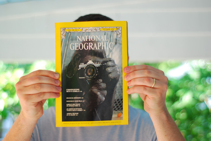 Peter holds up a National Geographic from October, 1978, his birth month. Notice the gorilla with camera. Any similarities?