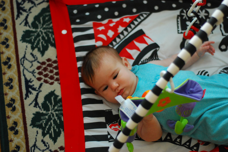 Esme in her play gym