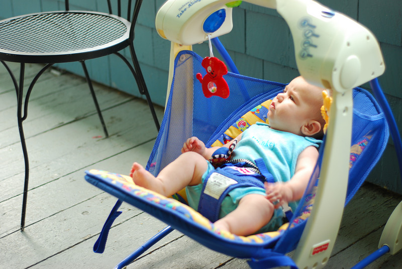 Esme in her swing on the porch at Five Gates.