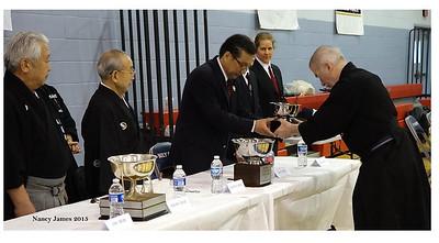 John returning 2014 trophy