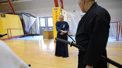 Kishimoto sensei demonstrating Do cut.  Notice sword does not go over the head but travels in front of the forehead and down to waist.