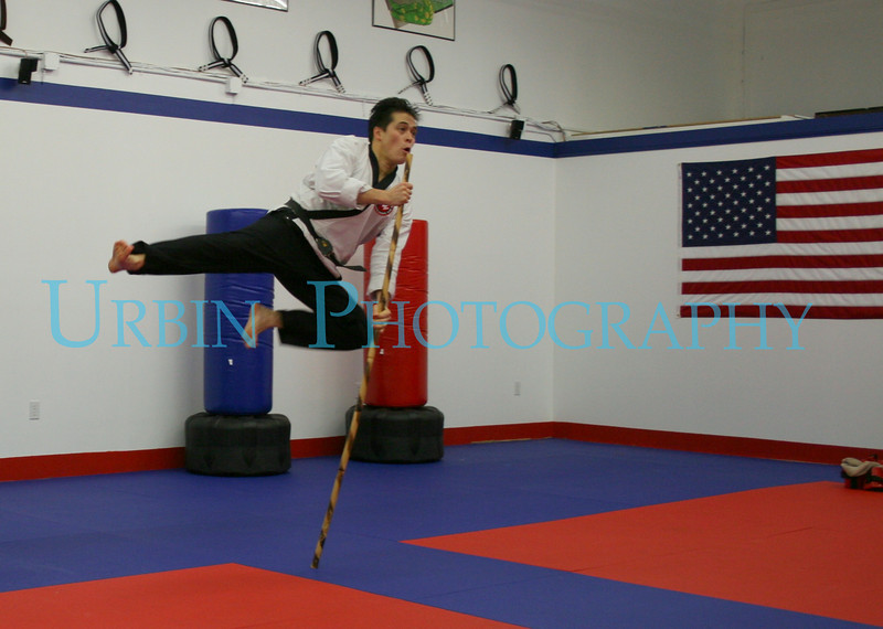 "<a href=""http://www.metrowestmartialarts.com/"">MetroWest Martial Arts & Wellness</a> instructor Carl Adams is doing a bo staff assisted flying side kick that is part of a two man staff form."