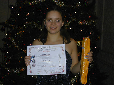 Megan with her Yellow Belt and diploma