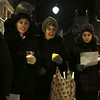 HOLLY PELCZYNSKI - BENNINGTON BANNER Cora Delucia and Susan Delucia of Bennington hold candles with Lydia Boekholt visiting from the Netherlands on Monday evening at the Four Corners intersection in Bennington. Candles were lit to celebrate Martin Luther King Day, and to celebrate peace. The candlelight vigil and procession started at the Four Corners was led to Oldcastle Theatre in Bennington.