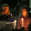 HOLLY PELCZYNSKI - BENNINGTON BANNER  Lin Lavallee and Ann Marrin of Bennington hold a candlelight in remembrance of Martin Luther King, on Monday evening at the Four Corners intersection in Bennington. Candles were lit to celebrate Martin Luther King Day, and to celebrate peace. The candlelight vigil and procession started at the Four Corners was led to Old Castle Theater in Bennington.