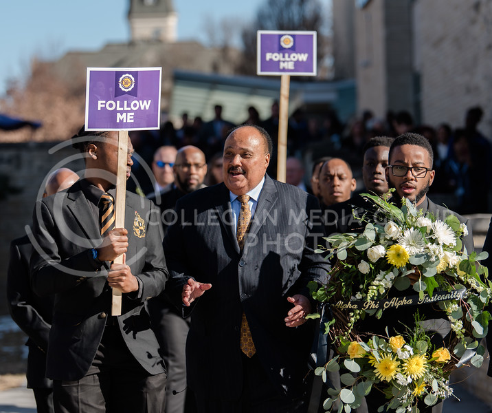 Proceeding from Forum Hall at the K-State Student Union, Martin Luther King III speaks with his fraternaty brothers from Alpha Phi Alpha after his lecture. Martin Luther King III helped Kansas State University celebrate on Thursday the 50th aniv. of the orignial visit of his father and for the Dr. Martin Luther King Jr. Observance Week (Olivia Bergmeier | Collegian Media Group)
