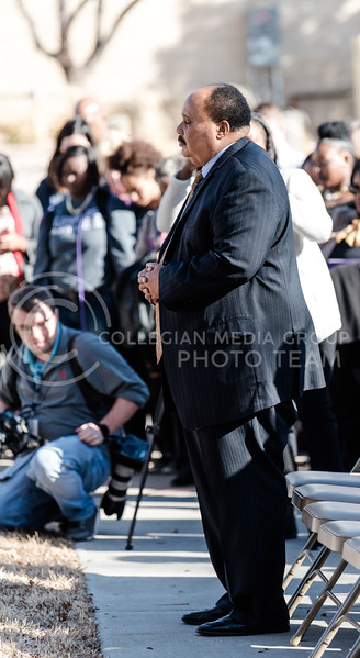 With a relaxed expression, Martin Luther King III listens intently to the paster pray during the annual Laying of the Wreaths around his father's bust near Ahearn Fieldhouse. Martin Luther King III celebrated the 50th aniv. of his father's visit on Thursday for the Dr. Martin Luther King Jr. Observance Week at Kansas State University. (Olivia Bergmeier | Collegian Media Group)