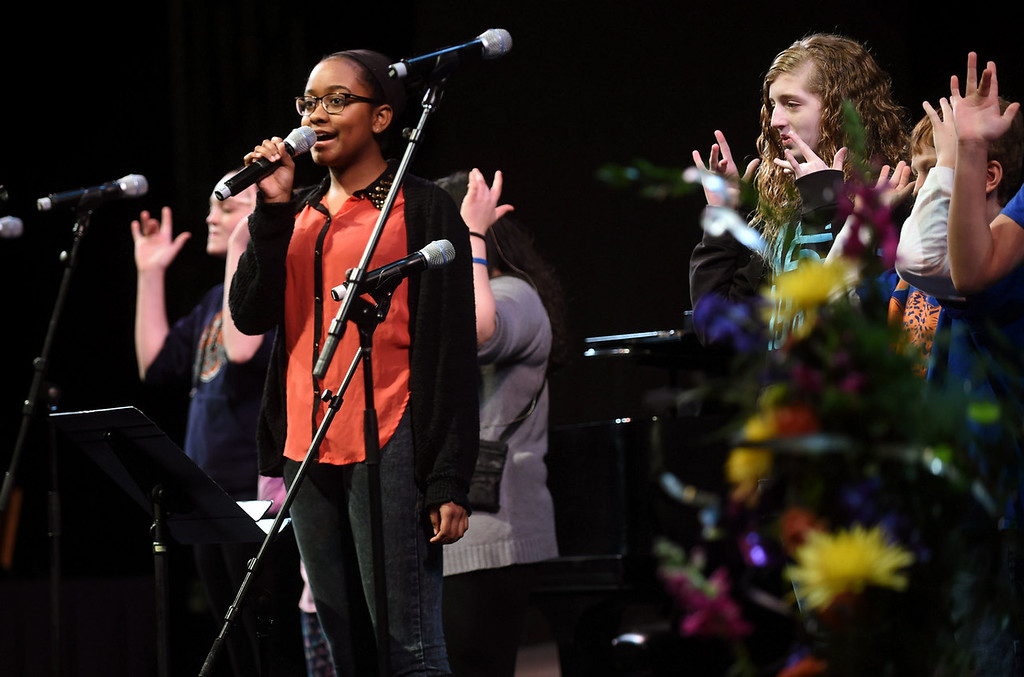 . Amani Ward sings the National Anthem, accompanied by Metro Deaf Academy, at the Ordway Center in downtown St. Paul as part of the Martin Luther King, Jr. Statewide Holiday Celebration Monday. (Pioneer Press: Scott Takushi)