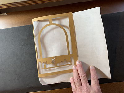 fitting the parchment in the paper cut frame