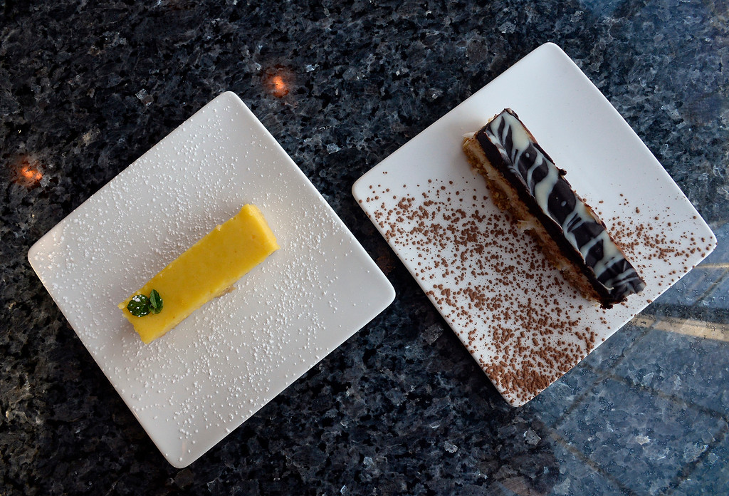 . LONGMONT, CO: November 20:   The coconut almond bar, and the lemon bar. Martinis Bistro in Longmont is being reviewed. (Photo by Cliff Grassmick/Staff Photographer)