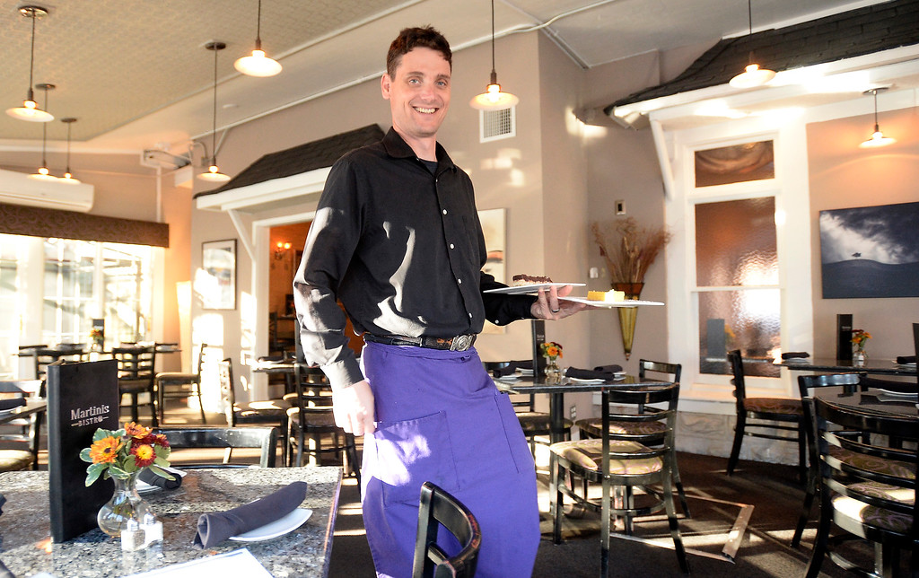 . LONGMONT, CO: November 20:  Anthony Ilacque brings out one of the dishes that was reviewed.  Martinis Bistro in Longmont is being reviewed. (Photo by Cliff Grassmick/Staff Photographer)