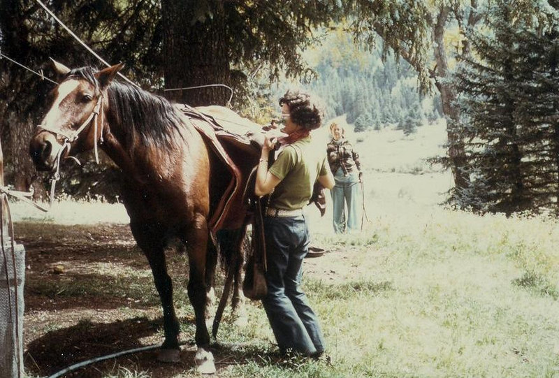 Sue Fesler learning how to unsaddle her horse at the East Fork Ranch.  Virginia Bramwell in the background giving instructions.