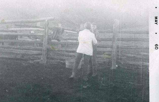 PAGOSA: Marvel and one of her jr high boyfriends, Chet Miller in the corral.  To impress him, she took him into the barn to show him the bull.  The bull would not let them out so Marvel had to stay on the feed manger and tear off a board to get through the side.  She did not tell her parents!
