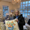 Tricia Eckel of Westford admires a beautiful pillow.