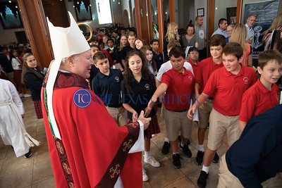 Bishop Edward J. Burns greets students after a celebration of Mass at Mary Immaculate Catholic Church to celebrate the 60th anniversary of Mary Immaculate Catholic School August 30. (Jenna Teter/Special Contributor)