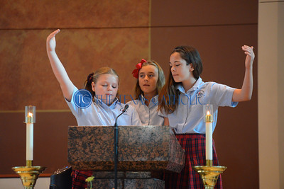 Students lead the Responsial Hymn during an all-school Mass August 30 at Mary Immaculate Catholic Church to celebrate the 60th anniversary of Mary Immaculate Catholic School. (Jenna Teter/Special Contributor)