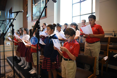 Nicholas Aulbaugh, end of first row, sings in the choir during an all-school Mass at Mary Immaculate Catholic Church August 30 to celebrate the 60th anniversary of Mary Immaculate Catholic School. (Jenna Teter/Special Contributor)