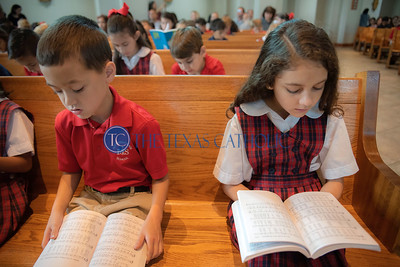 Daniel O'Shea and Francesca Soriano follow along in choir books during Mass to celebrate the 60th anniversary of Mary Immaculate Catholic School at Mary Immaculate Catholic Church on August 30. (Jenna Teter/Special Contributor)