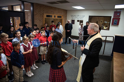 Bishop Edward J. Burns blesses Mary Immaculate Catholic School and its students, members of its church and school staff after presiding at an all-school Mass to celebrate the school's 60th anniversary August 30.