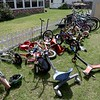 Mary Sirois has been a foster mom to over 200 kids at her home in Leominster and this is just some of the bikes that line her yard for all the kids the come go from her house.  SENTINEL & ENTERPRISE/JOHN LOVE