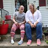 Mary Sirois, on right, has a good laugh with her adopted child Lauren Sirois, 17, who started out as one of her over 200 foster kids, at their home in Leominster on Wednesday afternoon. SENTINEL & ENTERPRISE/JOHN LOVE