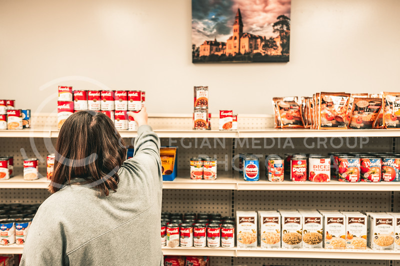 Mary Sutton,  incoming K-State graduate student and staff member for the Cat's Cupboard, is in charge of  stocking up the shelves and helping visiting people interested in the Cat's Cupboard located in Fairchild Hall.  March 25, 2021. (Dylan Connell | Collegian Media Group)