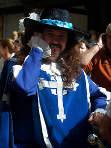 Musketeer on his cell phone. ...huh?