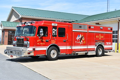 Mount Airy, Maryland Rescue 1 is a 2007 Spartan Gladiator/E-One equipped with a 1500/750 and serial number 131908.  The pump panel and cross lays are located behind the large roll up door behind the cab.