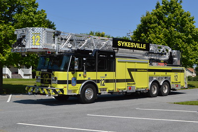Sykesville, Maryland in Carrol County operates this impressive 2016 E-One Cyclone II Extreme Duty HP 100' as their Tower 12.  Serial number 139914.  It replaces a 2003 E-One Cyclone 95' 2000/300 which was sold in 2016.  Something else new - Tower 12's cab is painted in black (other apparatus is white) and the addition of the black stripes.