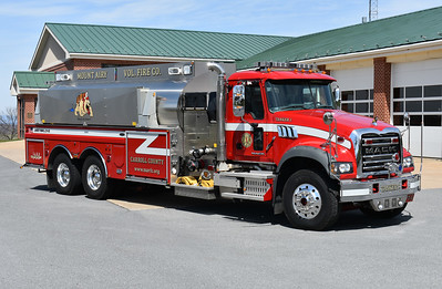 An officer side view of Tanker 1 from Mount Airy, a 2011 Mack Granite GU713/4-Guys with a 1500/3500.  4 Guys serial number F2755.