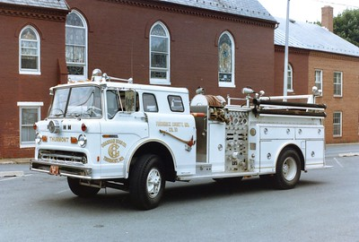 Engine 103 was a 1977 Ford C/Hahn, 750/500.  Sold to a department in Indiana in 1996.