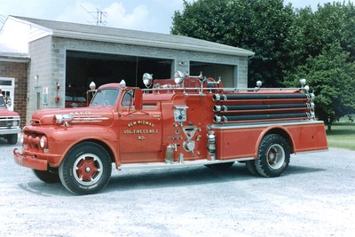 New Midway's former Engine 92, a 1952 Ford/Howe, 500/650.  Originally delivered with an enclosed cab, it was later removed to match their 1939 Pirsch/Howe.